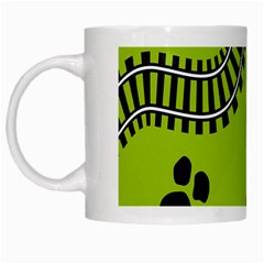 Green Prints Next To Track White Mugs